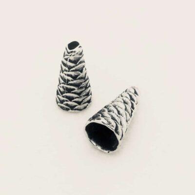 white bronze pine cone
